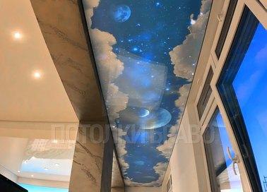 Матовый натяжной потолок с рисунком облаков и планет НП-569