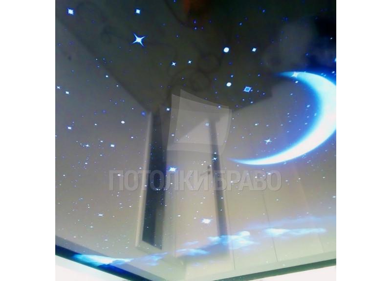 Темный натяжной потолок с голубыми изображениями НП-595